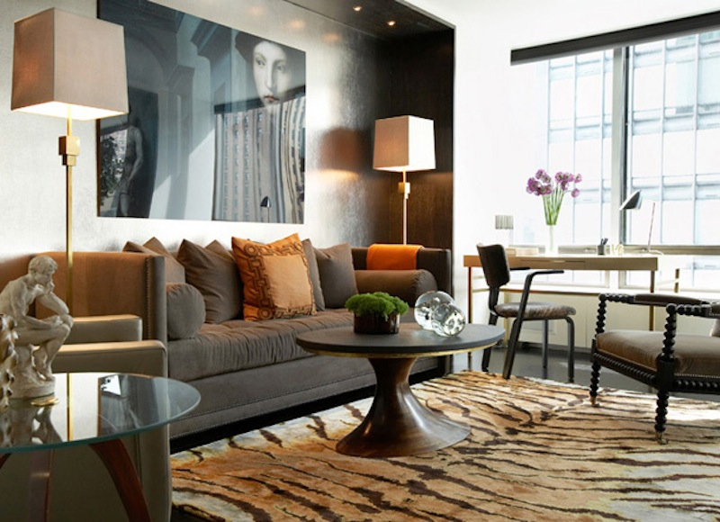 Masculine rooms eclectic living home for Masculine living room designs